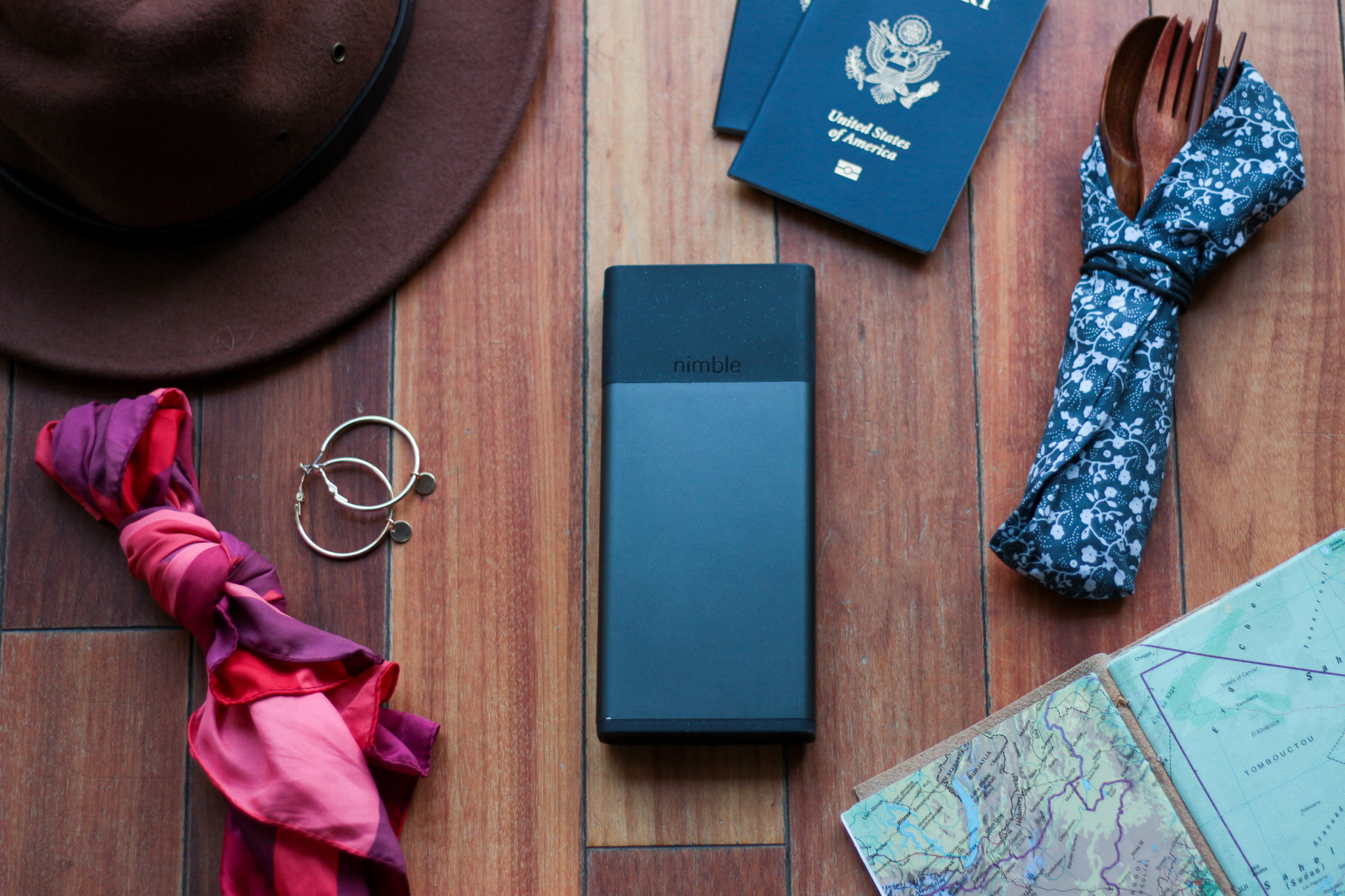 Nimble's 10-day charger surrounded by travel accessories. Photo by Misty Foster