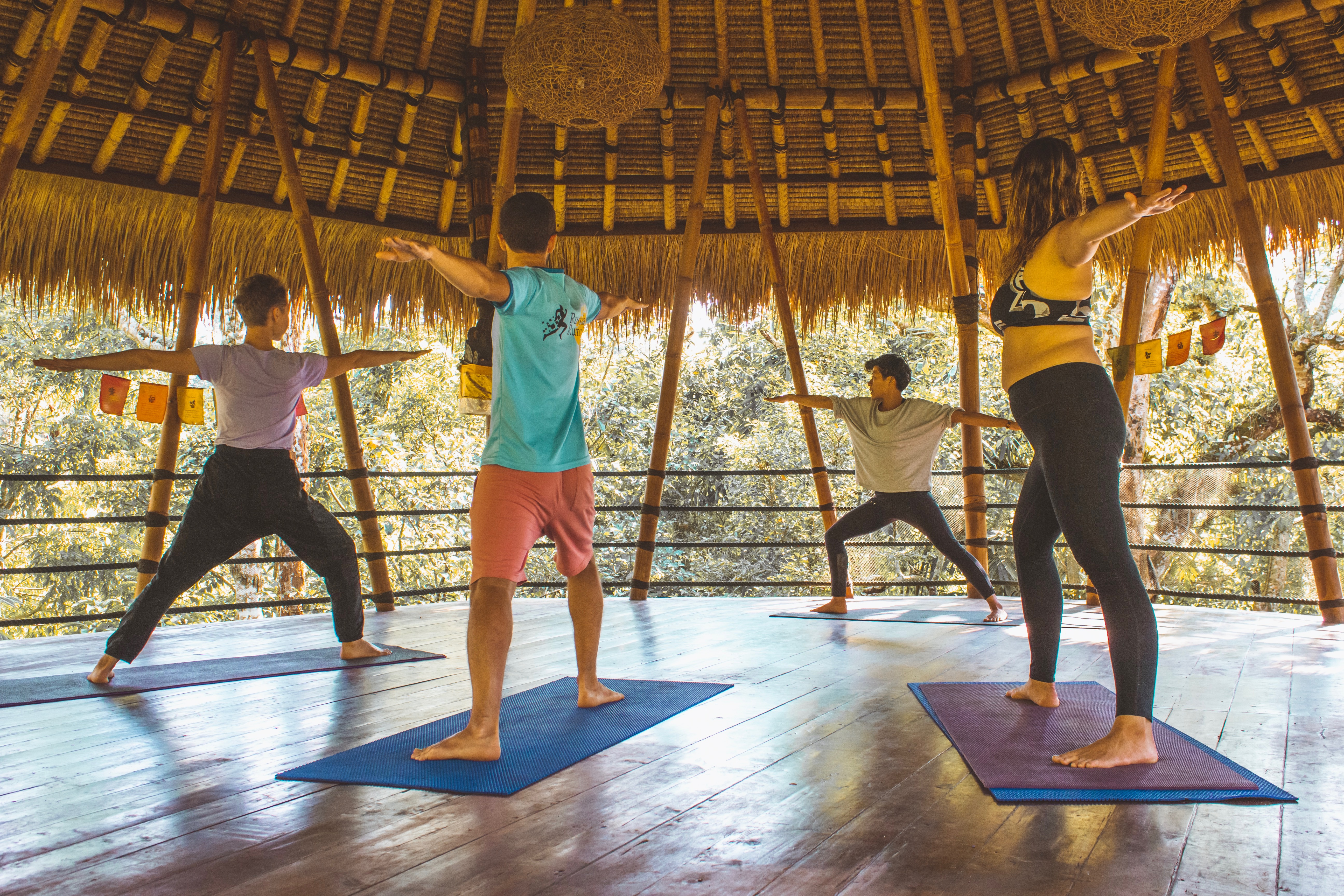 Practing yoga on the yoga palapa at Bali Eco-Lodge